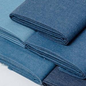 Stock woven 65% cotton 35% polyester blue dress denim summer fabric