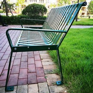 Metal garden bench with cast iron ends with four legs