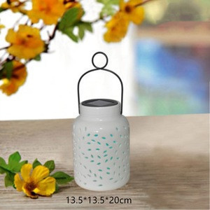 Solar ceramic patio garden lantern with changing color LED light
