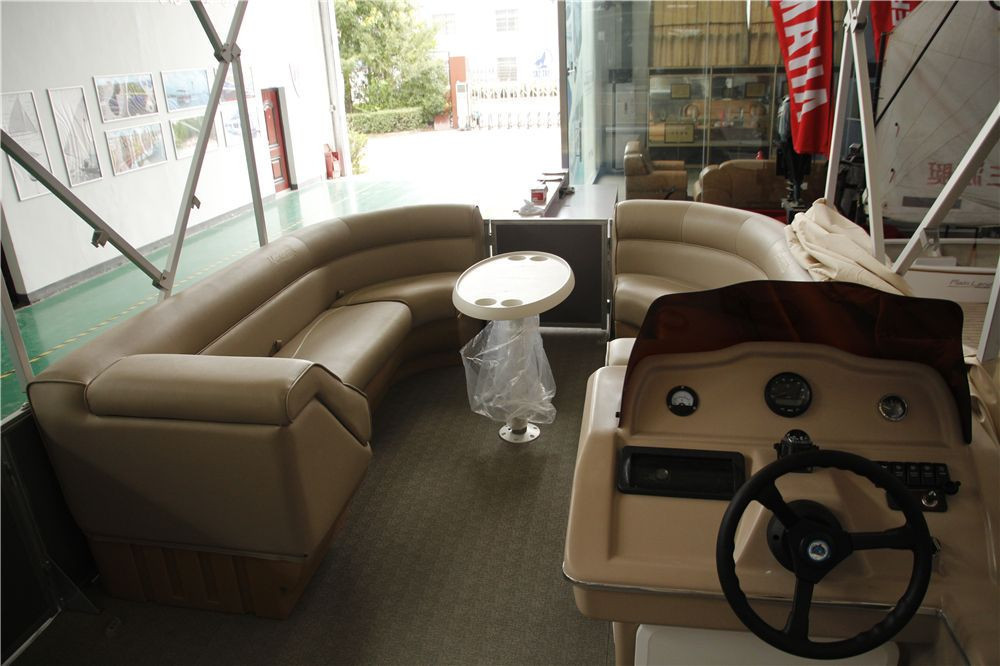 New aluminum pontoon boat with seagrass floor