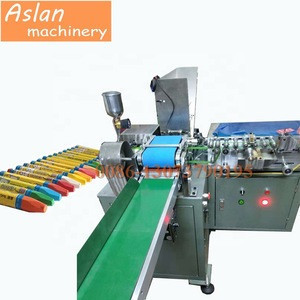 Wax crayon wrapper / oil crayon label machine / crayon wrapping labelling machine