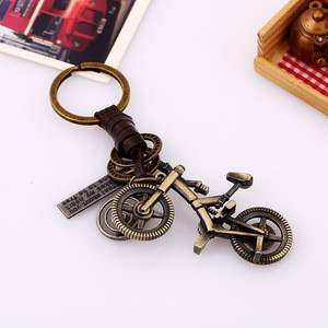Creative Key Chain Men's and Women's Leather Pendant Small Gift Alloy Bicycle Retro Woven Leather Key Chain
