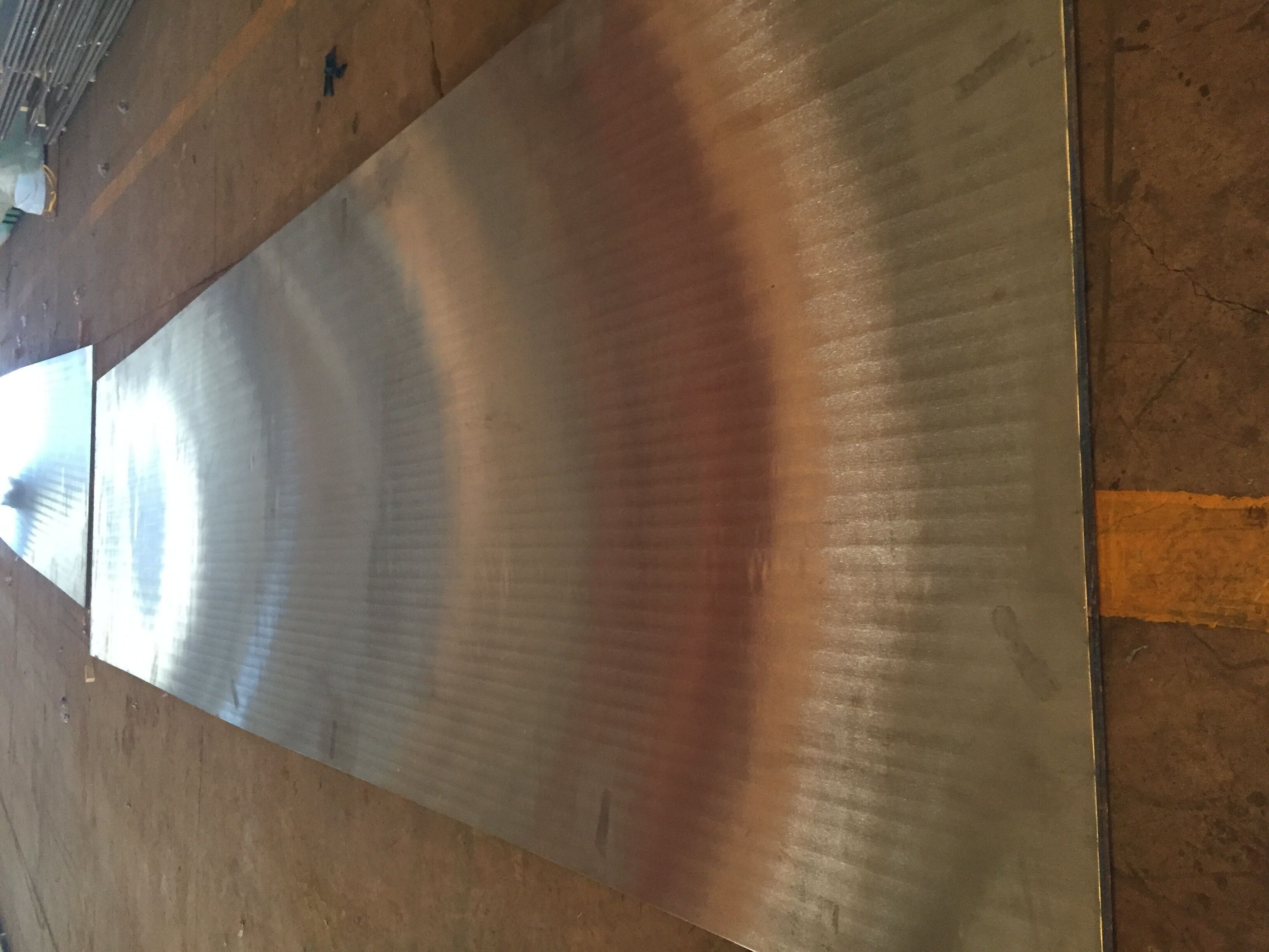 Carbon steel and stainless steel cladded material