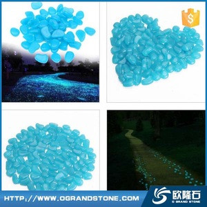 Blue glow paving stone in night glow in the dark pebble stone