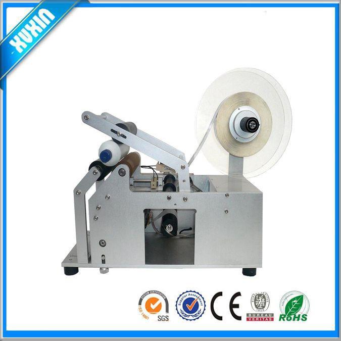 Semi automatic round labeling machine