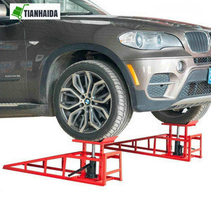 Hydraulic car ramp with lift function