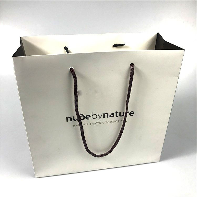 COMESTIC SHOPPING PAPER BAG WITH BRAND logo