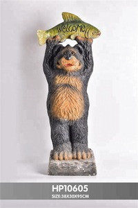 Handcrafted Polyresin Lovely Welcom statue of Bear carring salmon / flowers