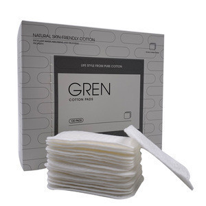 Organic cotton pad to clean the skin into a double square pad remover cotton cosmetic pad