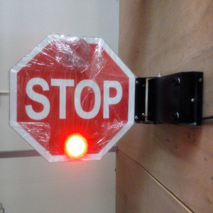 Vintage school bus stop arm with safety lights