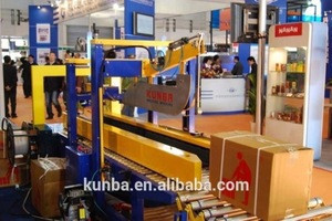 Automatic flap carton sealing machine and strapping machine packing line