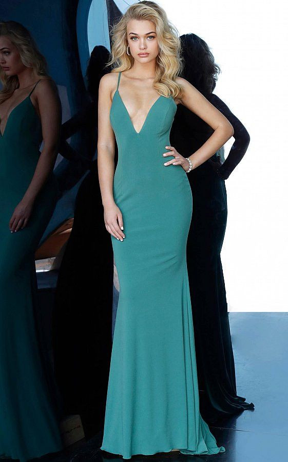 Form fitting prom dress floor length with train sleeveless bodice with plunging neckline spaghetti straps over shoulders low ruched back with criss cross spaghetti straps.