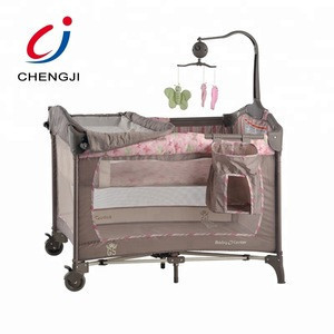 High quality electric baby bed swing baby crib with rattles