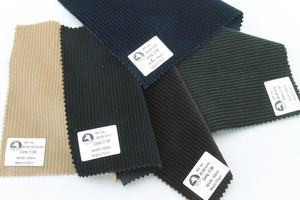 Hot selling in-stock 100% cotton corduroy fabric for garment trousers