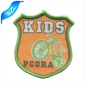 Wholesale merrow border custom brand name logo machine woven badges for school uniform