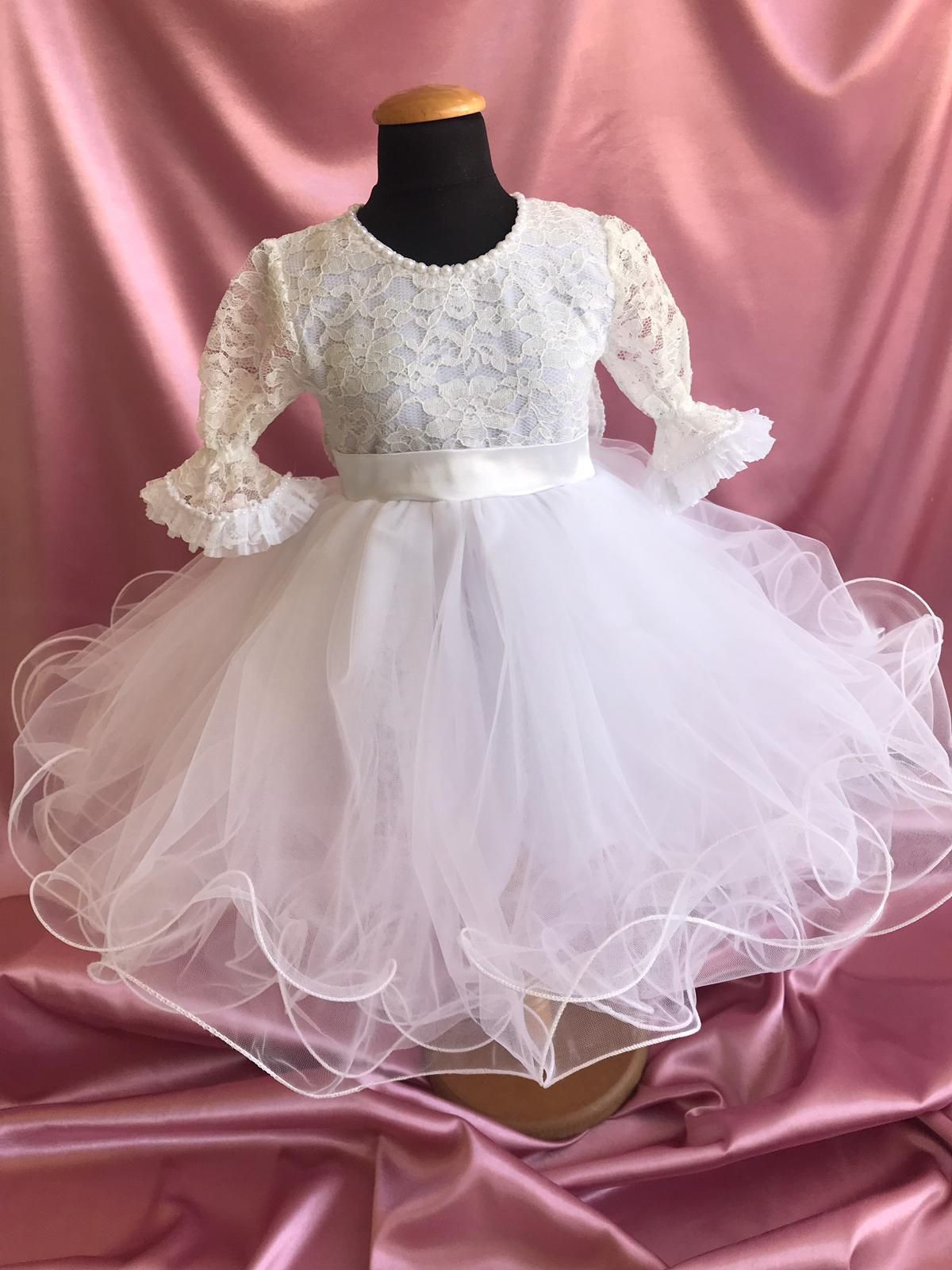 White & cute girl dress with tulle skirt