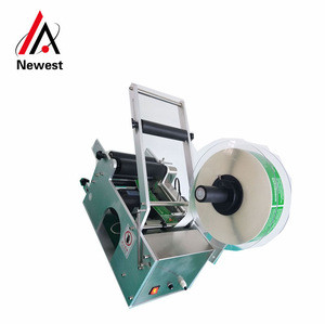 Hand automatic beer bottle labeling machine/professional tabasco sauce bottle labeling machine/round bottle labeling machine