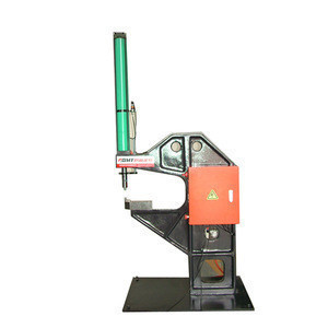 Air-hydraulic radiator clinching machine for round material fixing