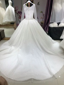 Elegant Sweet Heart Illusion Design Back Closure Long Sleeve Embroidered Wedding Dress With Train