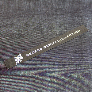 The woven label of custom clothing is a trademark of clothing manufacture